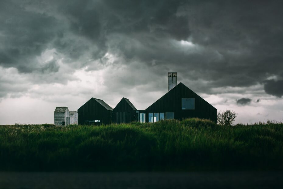 black-and-white-house-under-thick-clouds-833192